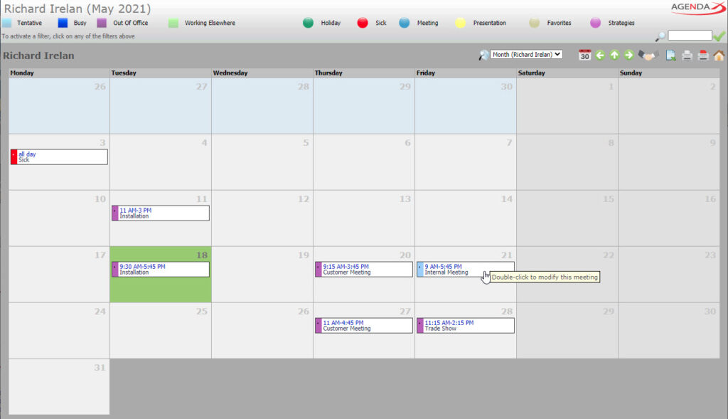AgendaX group calendar user specific view showing the monthly schedule of a single employee. Meeting details are shown in colored text boxes. The representation resembles a monthly wall calendar.
